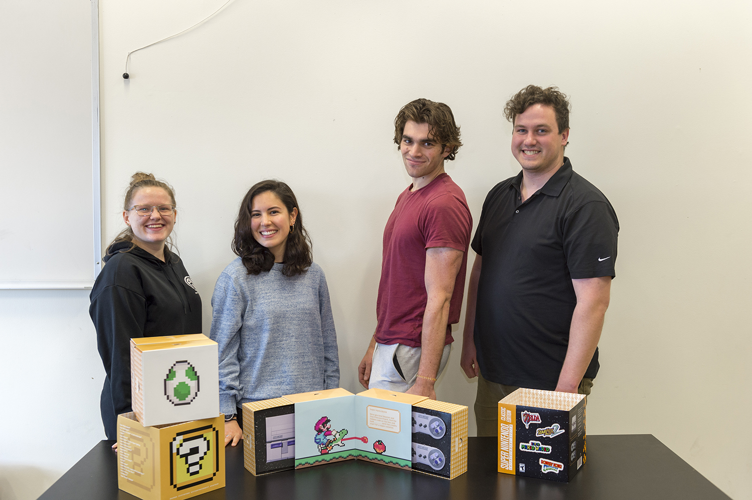 Team Tanooki poses with their packaging design