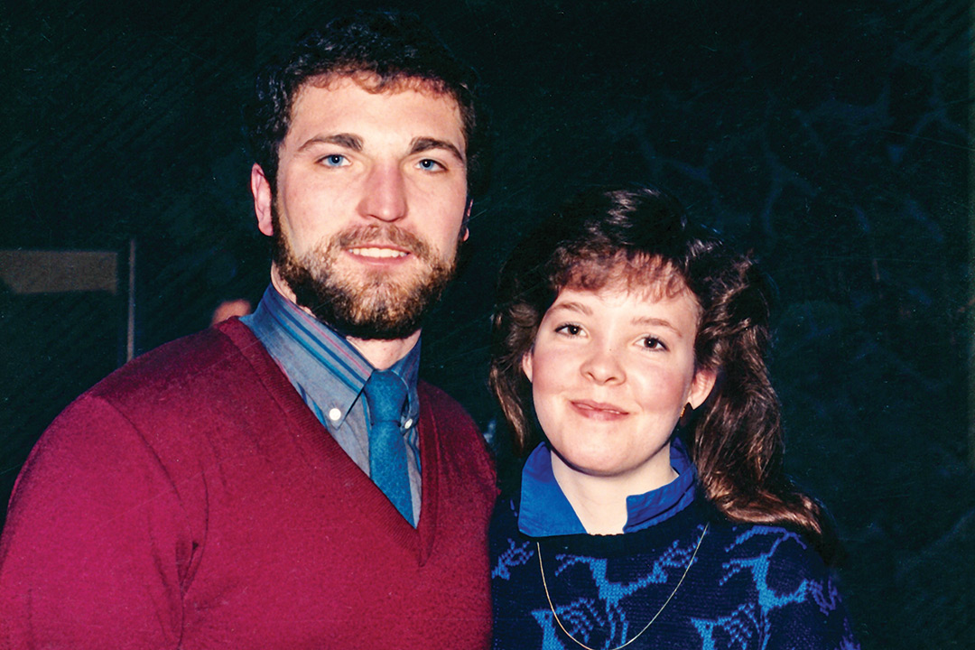 Couple from 1980s stand next to each other.
