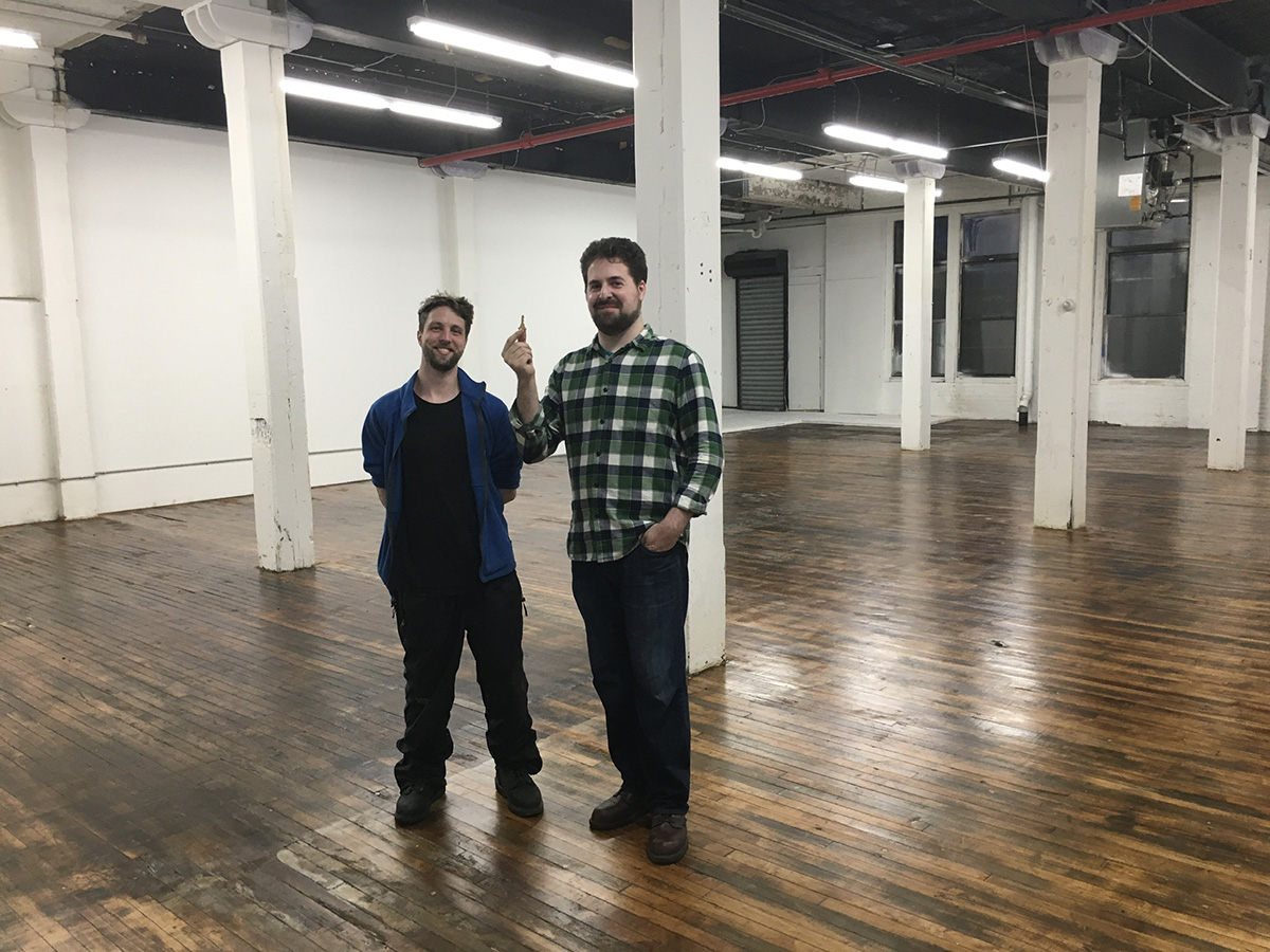 Adam Richlin and business partner David Finn in their office space.