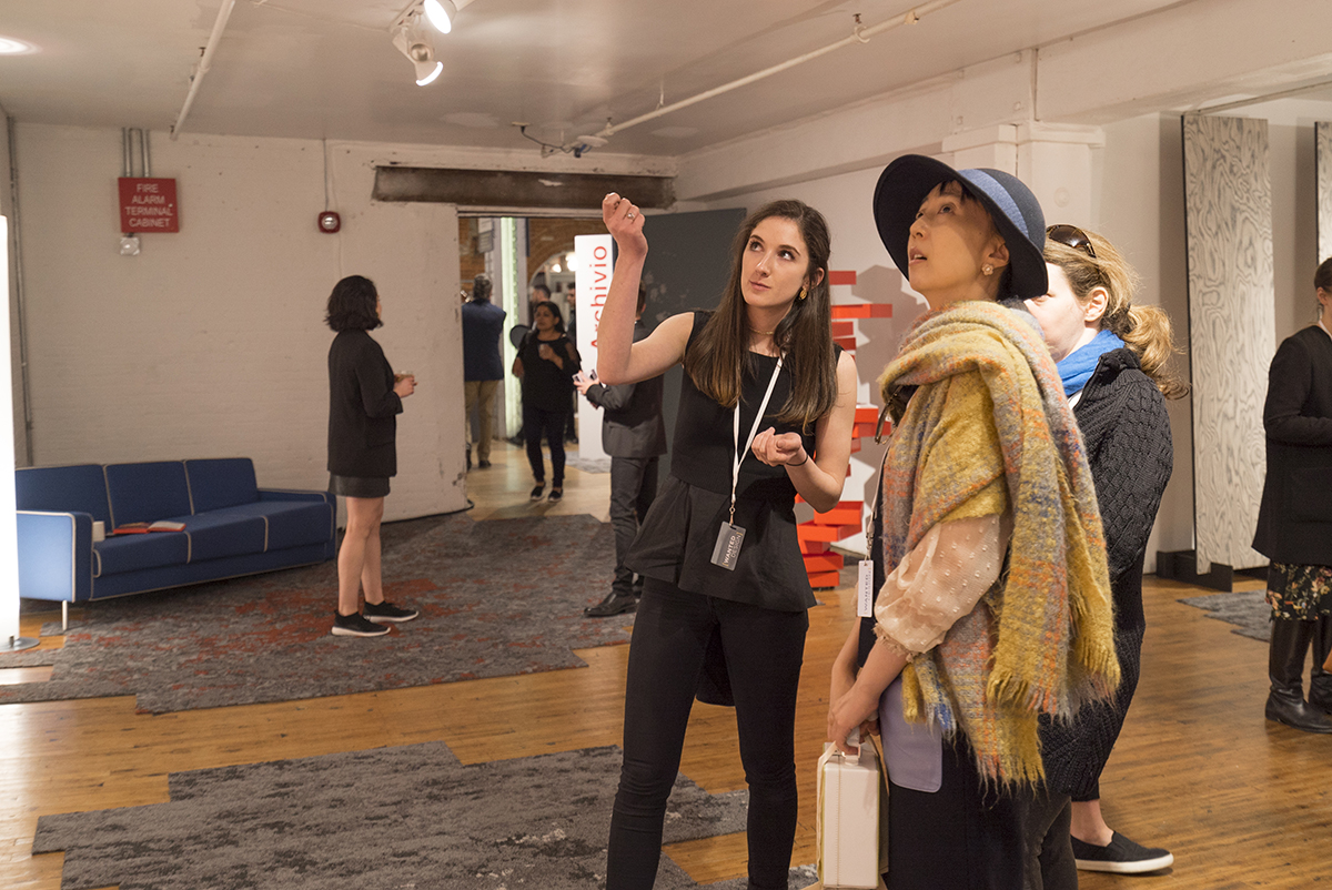 Samantha O'Neill interacts with an exhibit visitor.