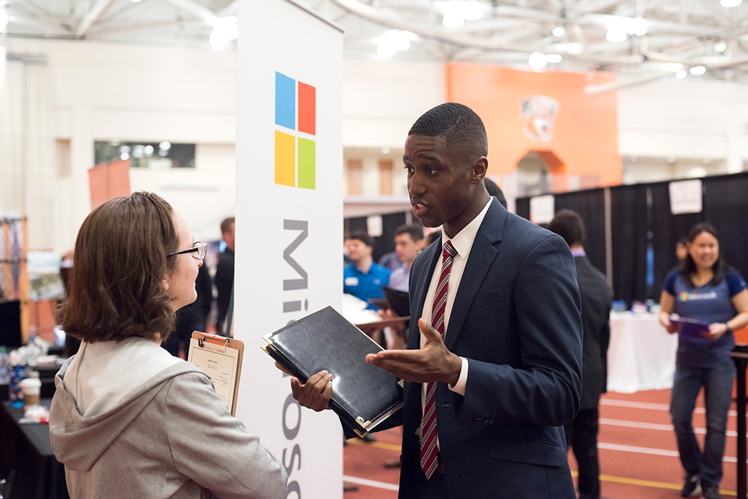 Student speaks with company rep