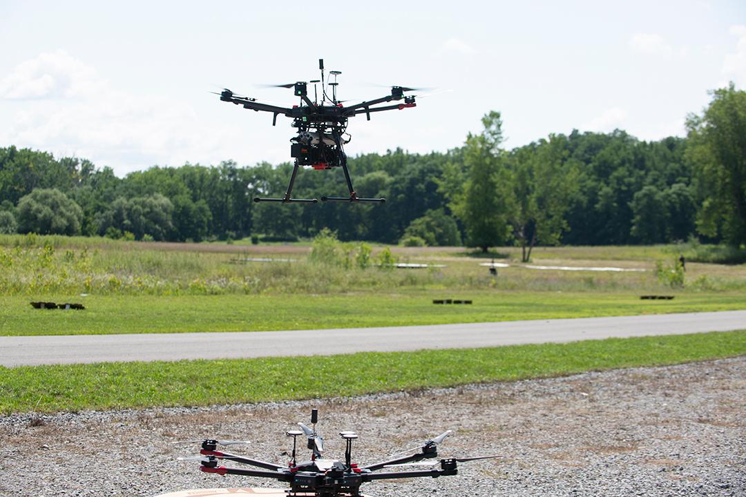 Two drones take flight.