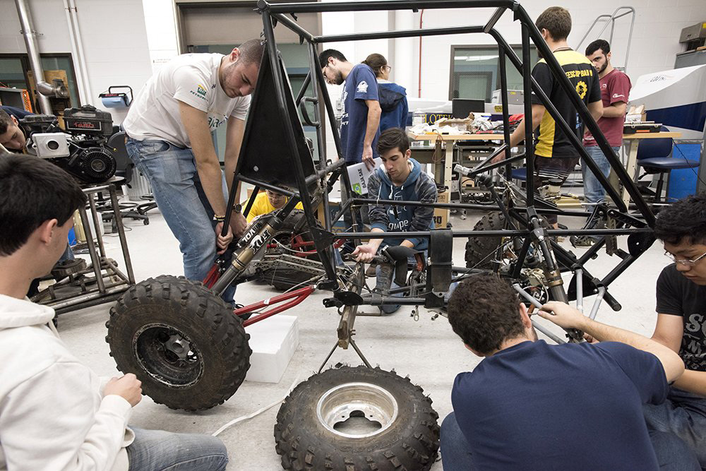 Students work on baja car.