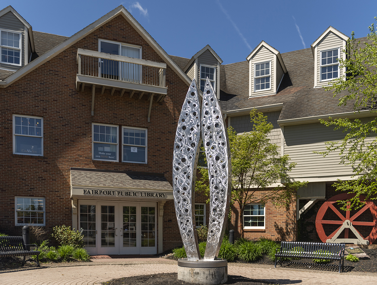 "The ""Connection"" sculpture stands tall outside of the Fairport public library."