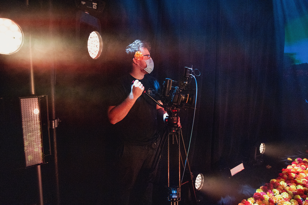 Student Simon Yahn operates a camera.