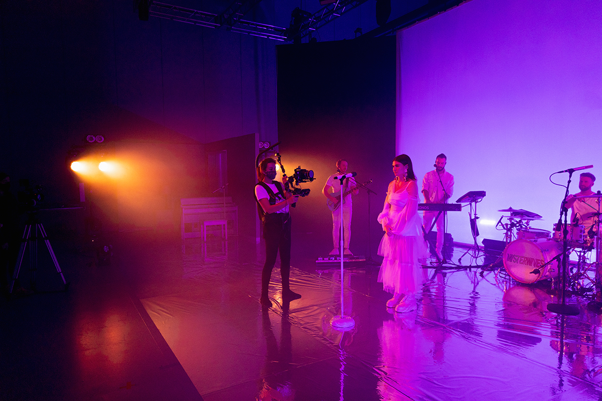Main camera operator Carrie Stalk films MisterWives while it performs.