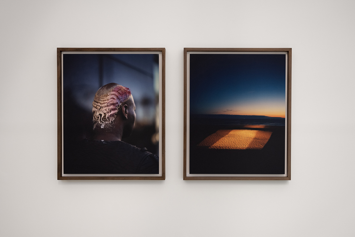 Side-by-side photos on a gallery wall.