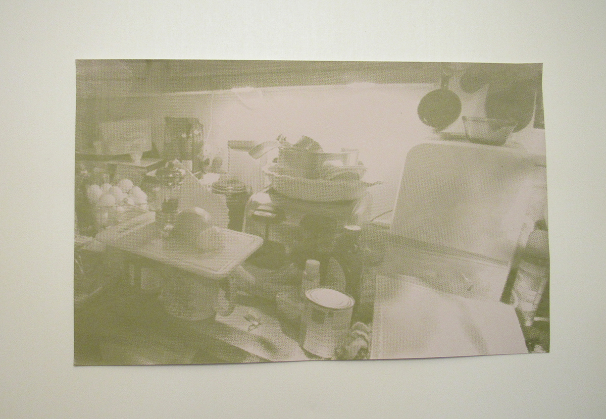 A green-tinted print of supplies sitting on a surface.