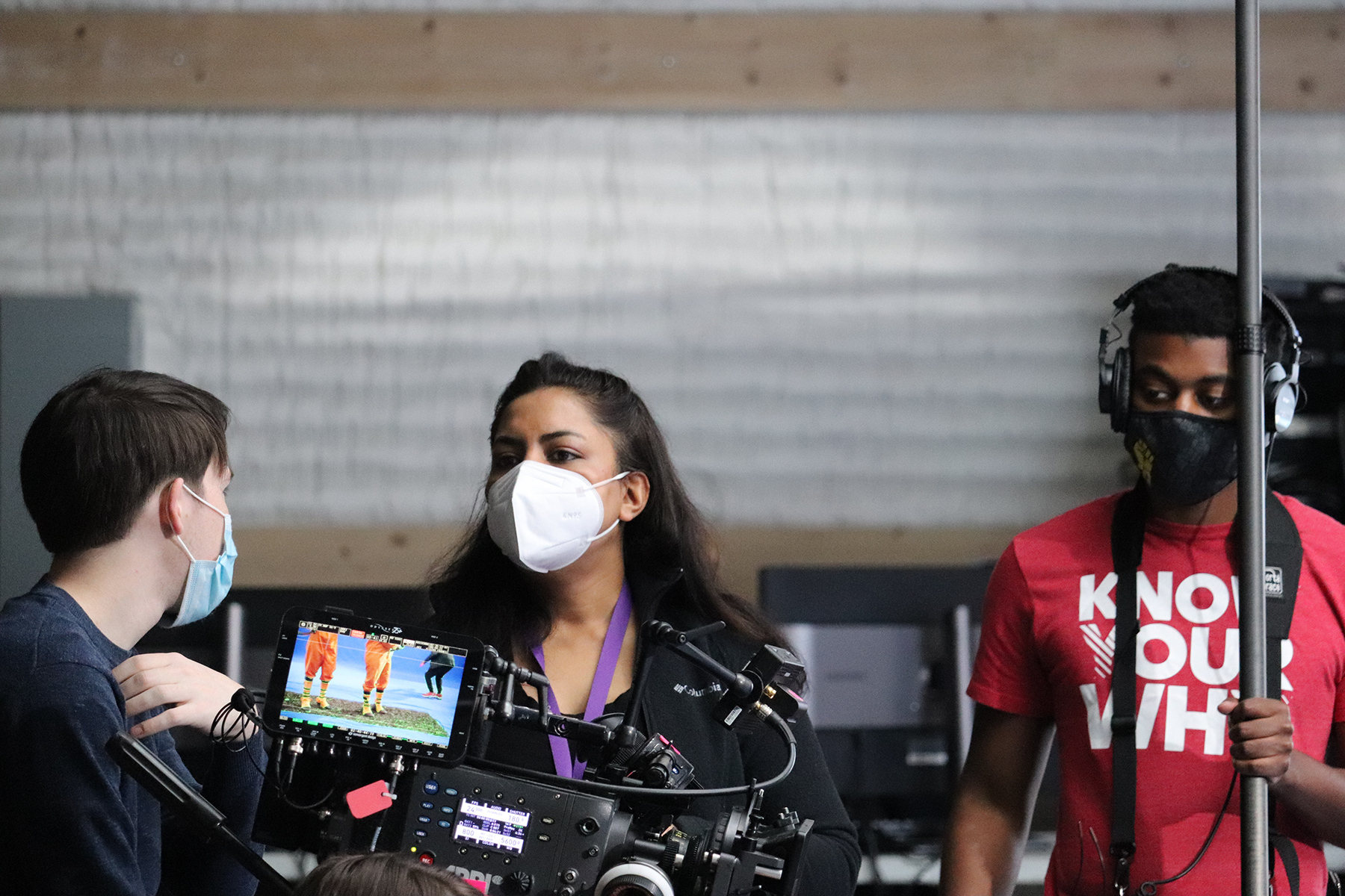 Ambarien Alqadar talks with students on the set.