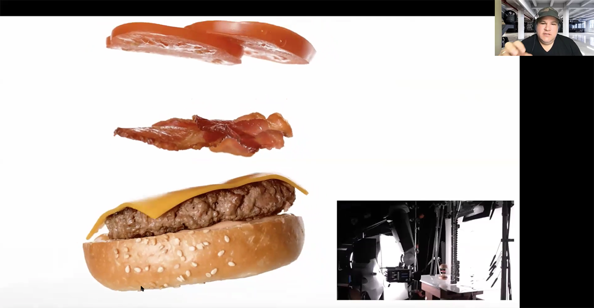 A screenshot of cheeseburger ingredients flying through the air for a photo shoot.