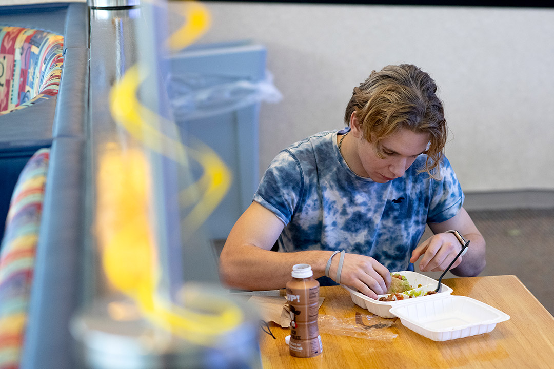 student eating at a table.