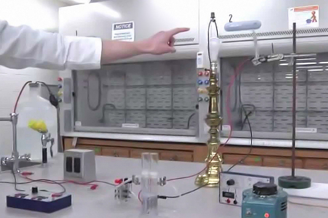 experiment involving lamp hooked up to controls and meters.