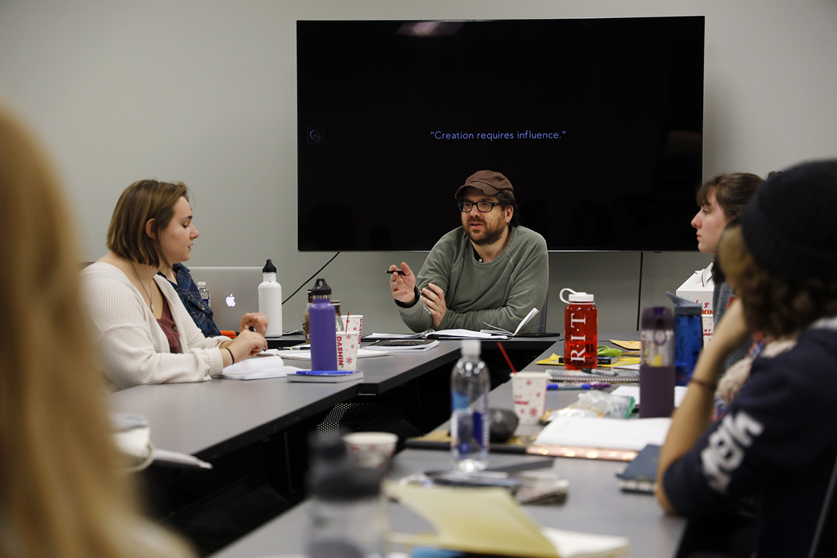 Eric Maierson leads a workshop for a group of photojournalism students