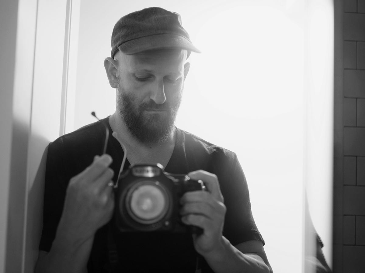 Greg Halpern taking a photo of himself in the mirror.
