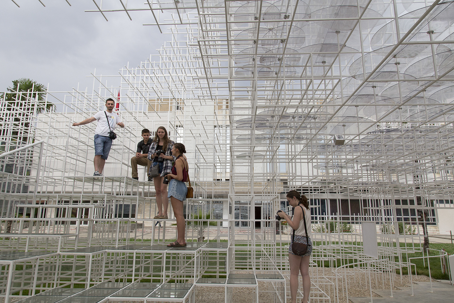Students pose on a weird structure