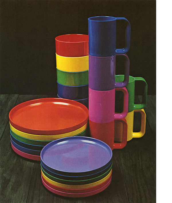 A collection of rainbow-colored mugs