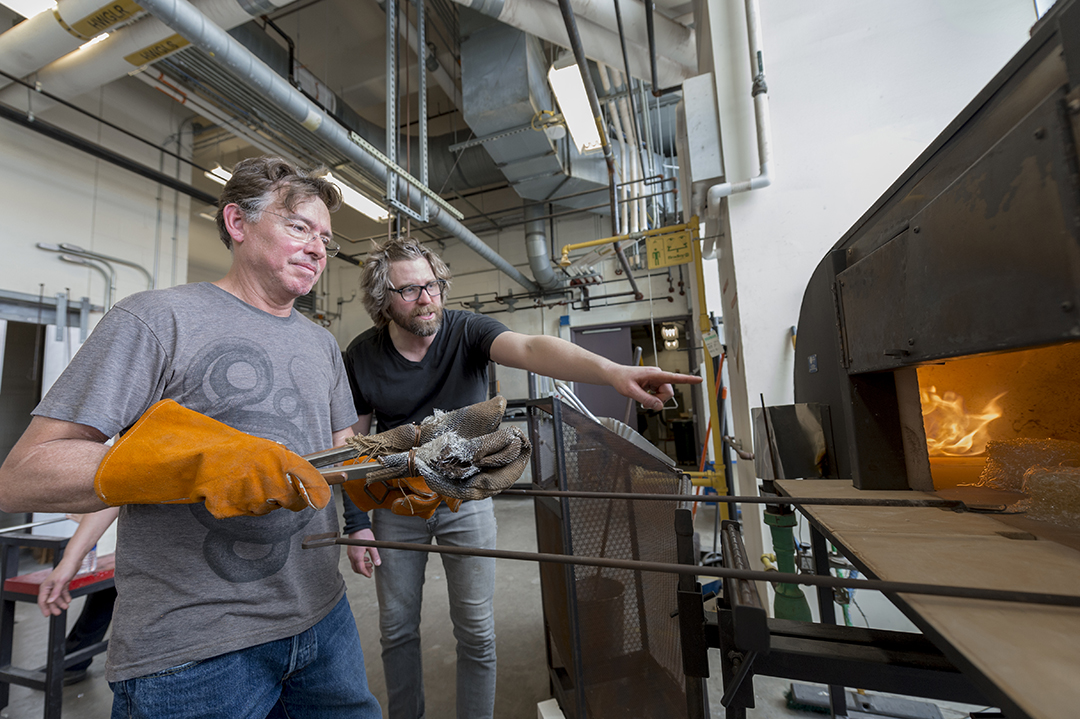 Peter Houk and David Schnuckel work together in the hot shop