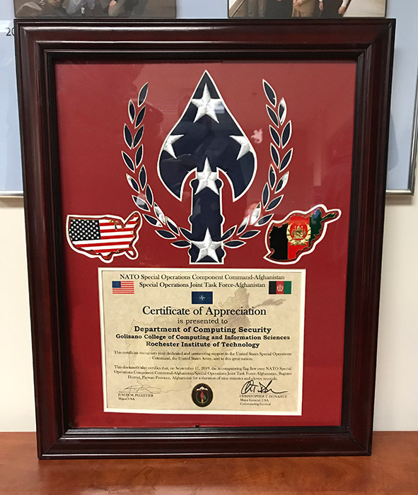 Framed plaque reads: Certificate of Appreciation presented to Department of Computing Security.