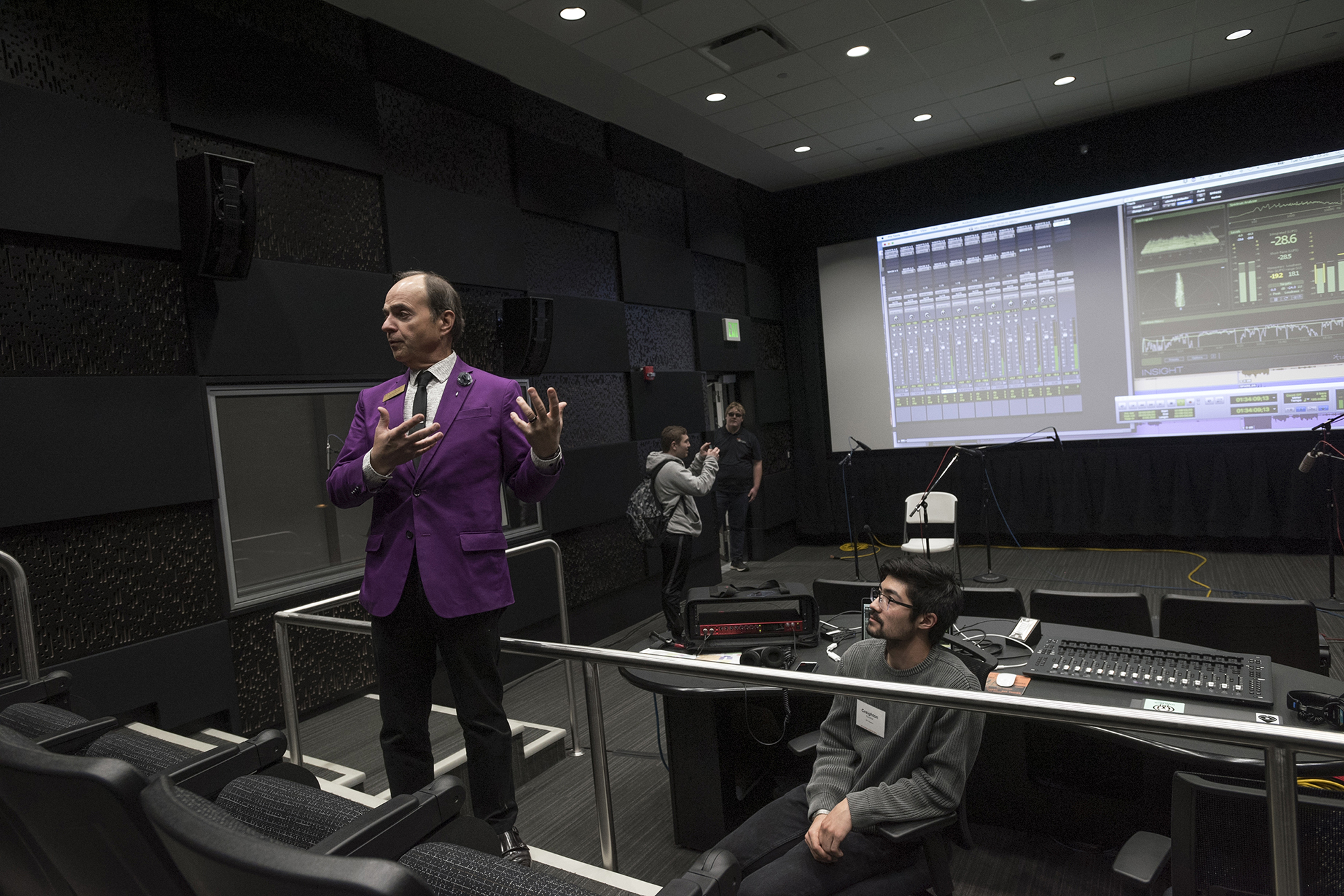 Dave Sluberski presents in MAGIC Spell Studios' sound mix theater as Creighton Yanchar sits behind the controls.