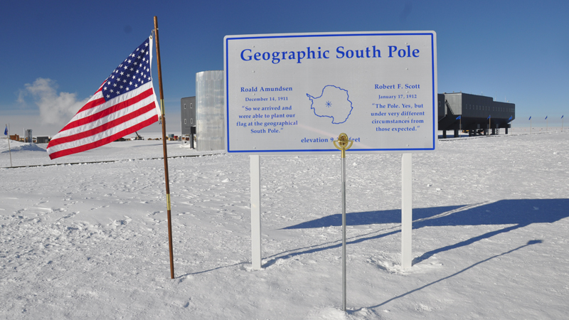 American flag next to south pole sign