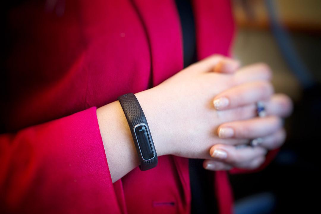 Fitbit bracelet on researcher's wrist.