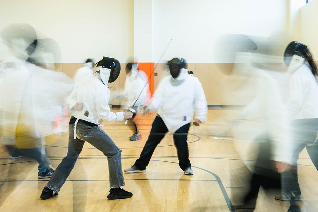 Students fencing.