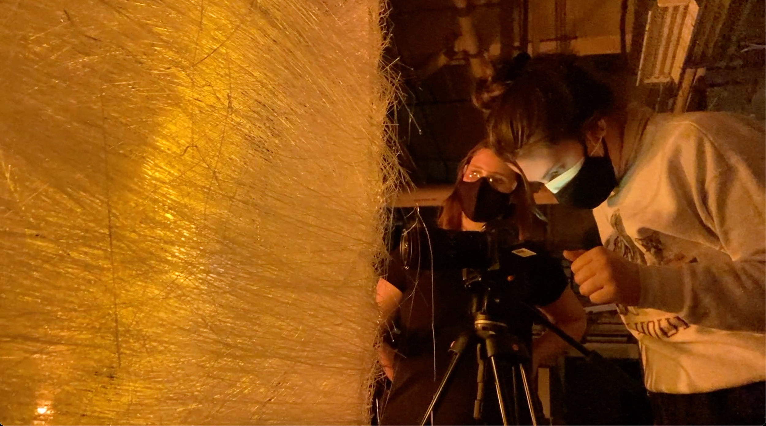 Trisha Pickelhaupt operates a camera to capture a large glass structure.
