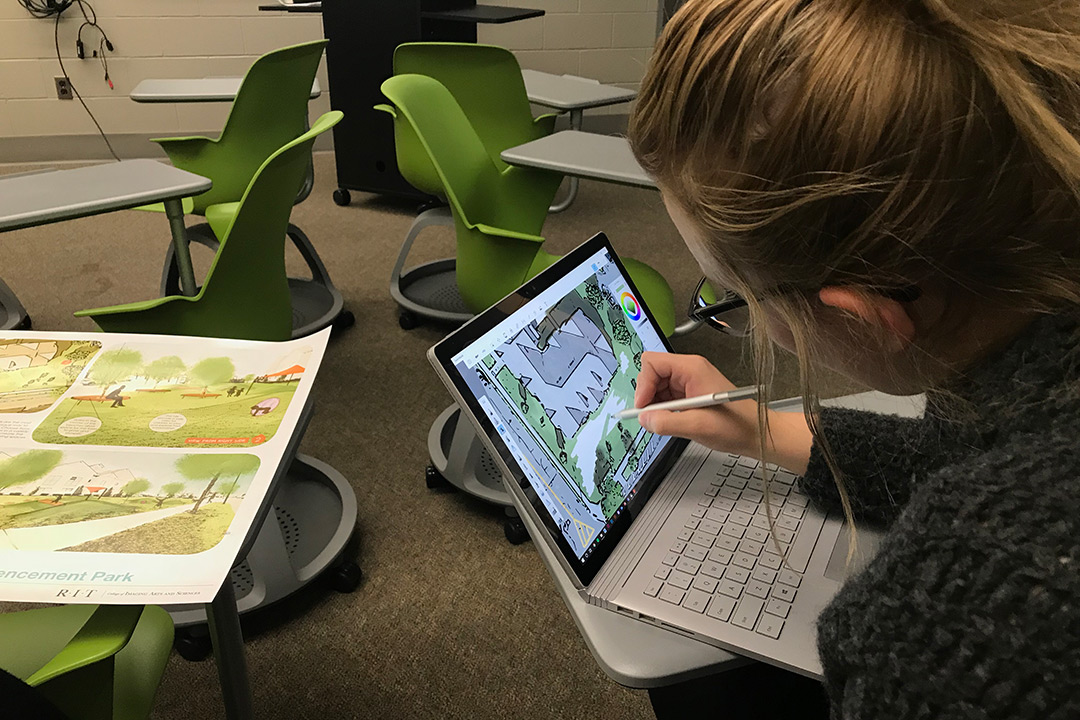 Stefani Schultz uses her laptop to digitally sketch out design ideas for the team's park.