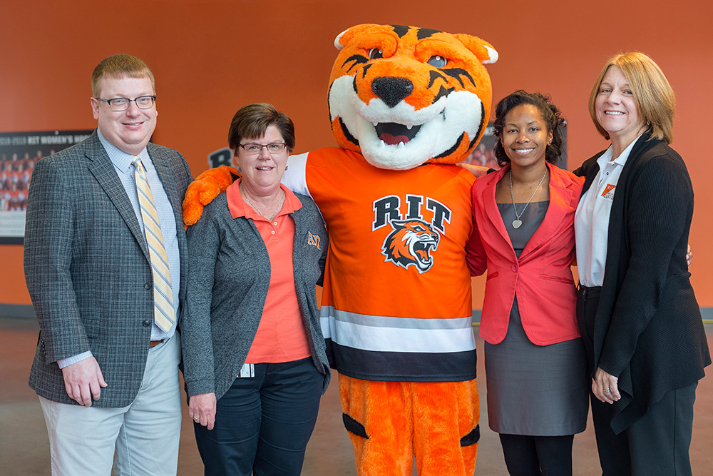 The winners of the Golden Brick Award pose for a photo with RITchie the Tiger, RIT's mascot.