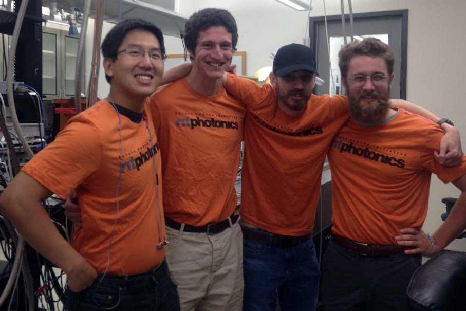 Austin Ford poses for a photo with three friends who also work at the Center for Detectors.