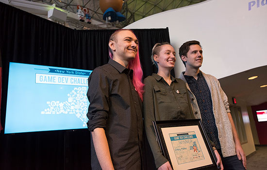 The RIT student team poses for a photo with their Game Dev Challenge first place certificate.