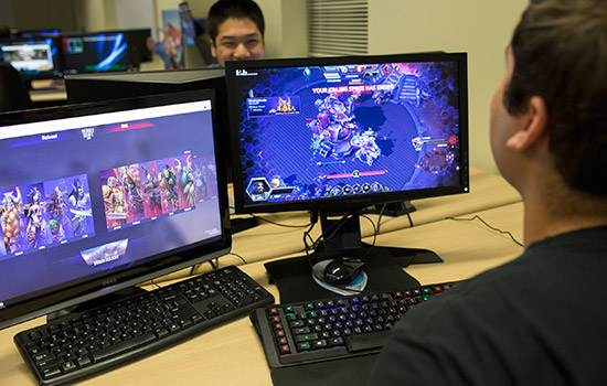 two students playing computer games.