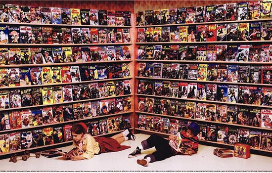 People reading in front of bookshelf