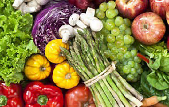 An artistic spread of different, brightly colored vegetables.
