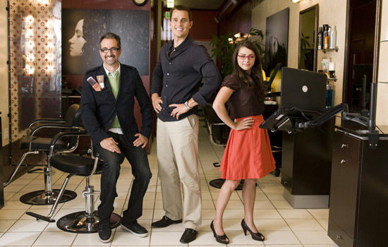 Three Television hosts posing in studio
