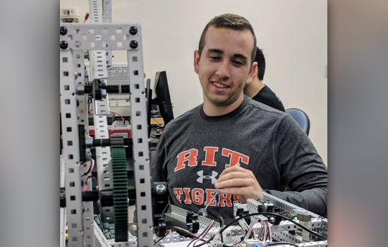 Shane Murphy works on a robot.