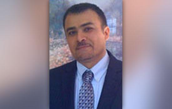 A headshot of Hamad Ghazle.