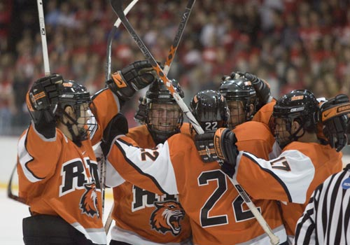 RIT Hockey players huddling together