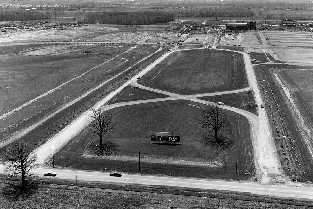 An aerial view of RIT's entrance in 1966. Much of the landscape is barren because the construction was not yet finished.