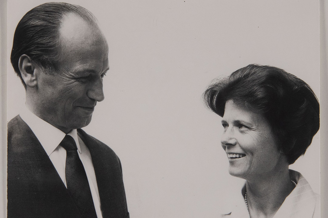 Hermann and Gudrun smile at each other in this black and white photo. They are pictured from the shoulders and chest up.