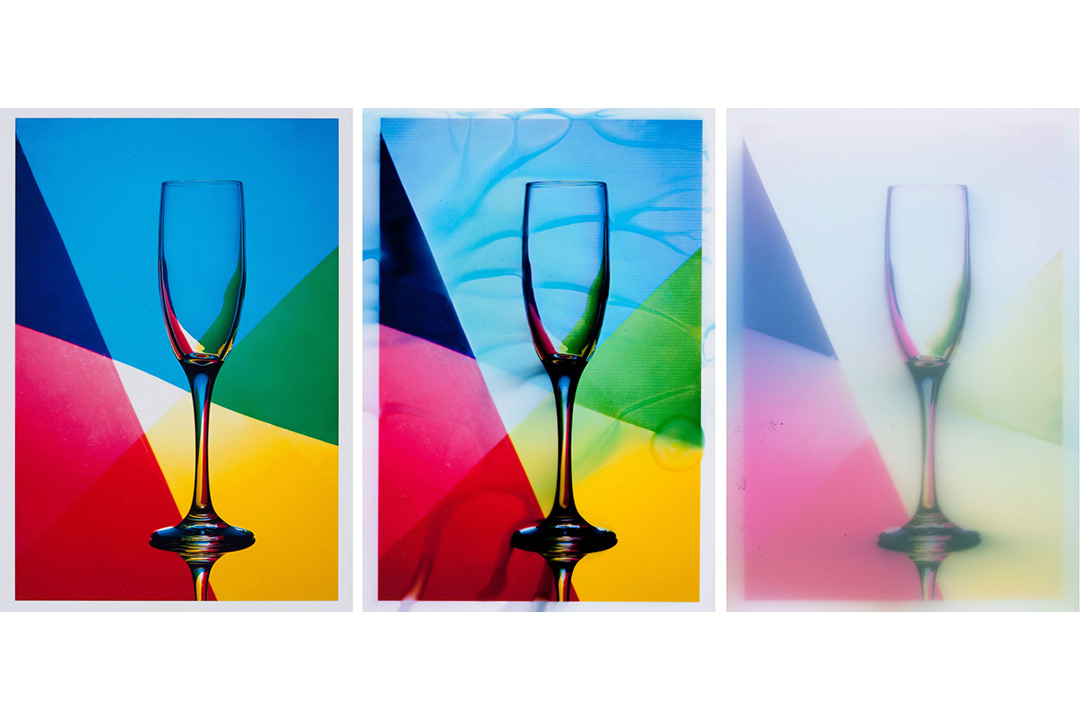 The three research test sample images are side by side. The photo is of a clear champagne glass with a geometric, rainbow background. The image on the left is very clear, the image in the middle is fairly clear but slightly distorted, and the image on the right is very faded and blurry.