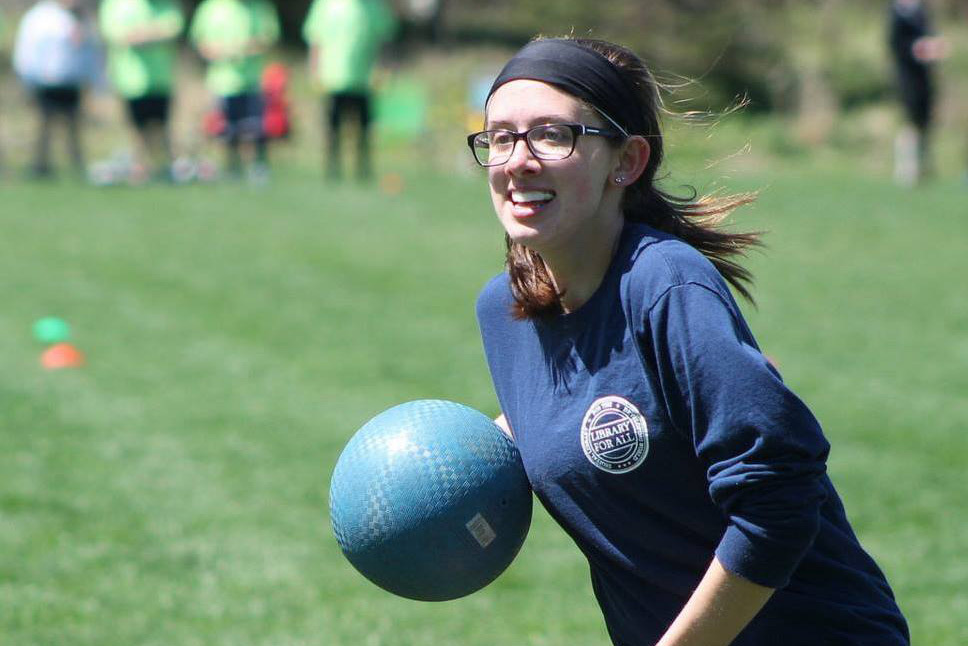 Laurel Perweiler running and carrying a ball while playing quidditch.