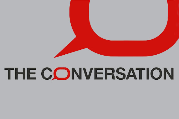 """""""The Conversation"""" in black text on gray background with red outlined speech bubble"""