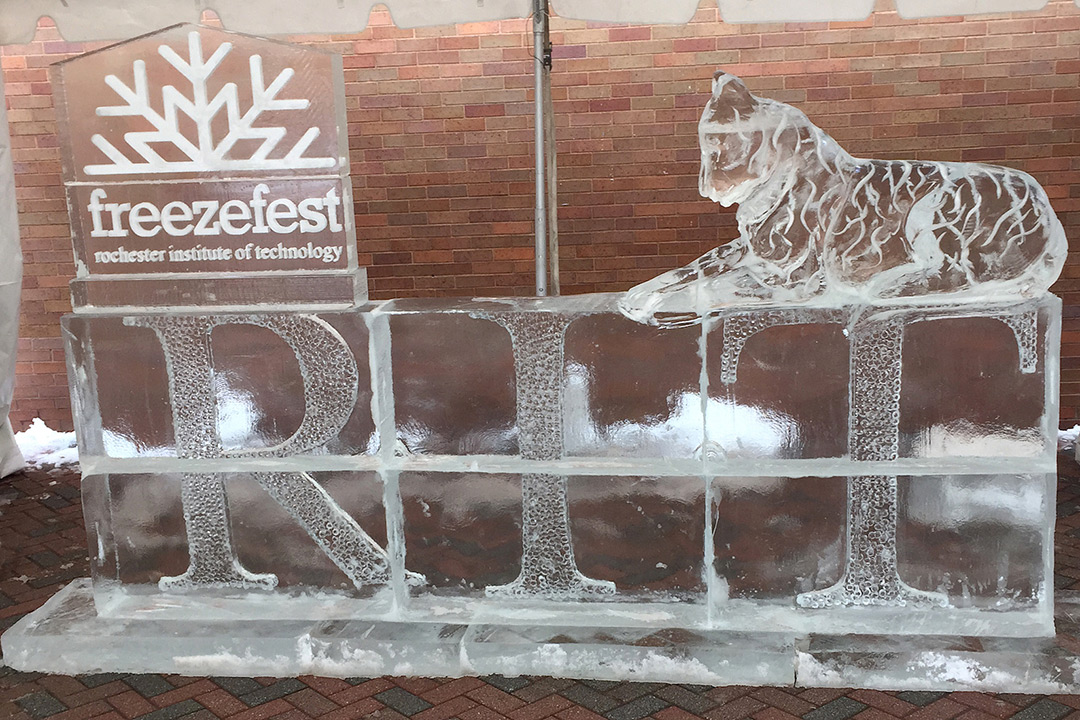 Ice sculpture of the word RIT with a tiger sitting on top