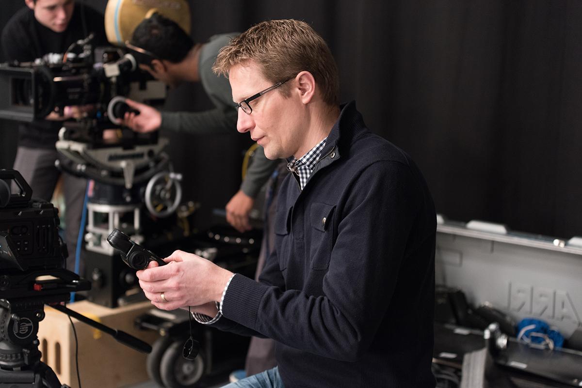Man in a film studio sits down