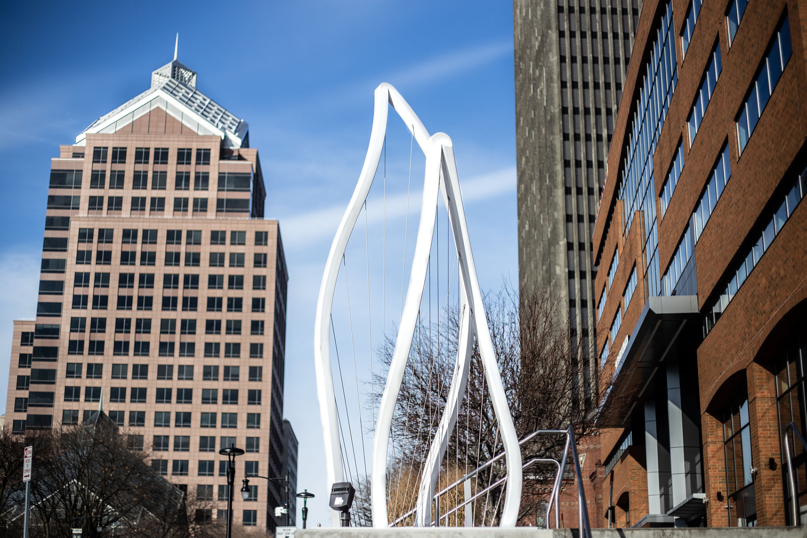 Julia Manson's second downtown Rochester sculpture sits in front of the 3 City Center office building.