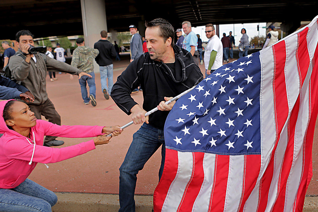 Man tried to pull American flag away from female protestor