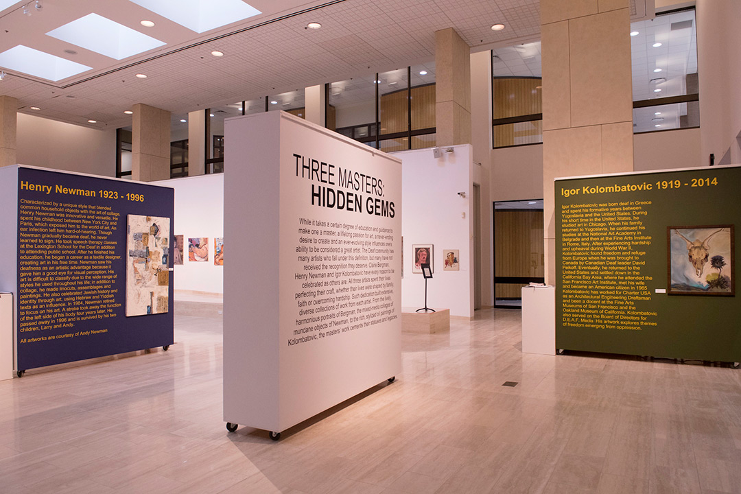 Art exhibit showcasing three artists