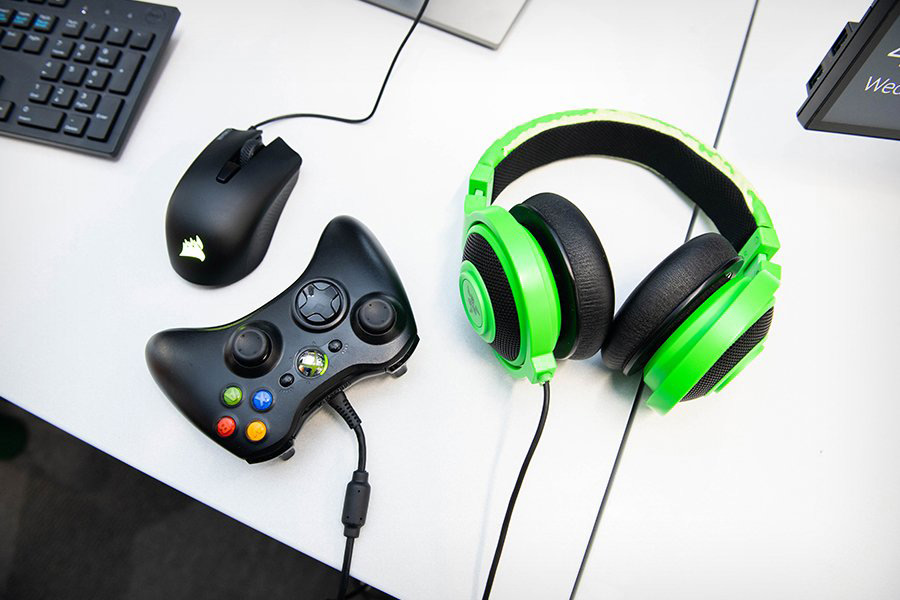 Computer mouse, Xbox controller and headphones.