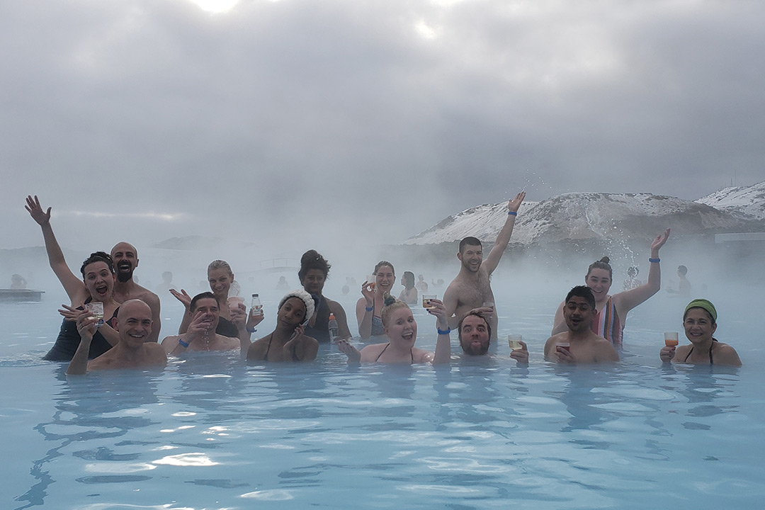 Group of people in lagoon.